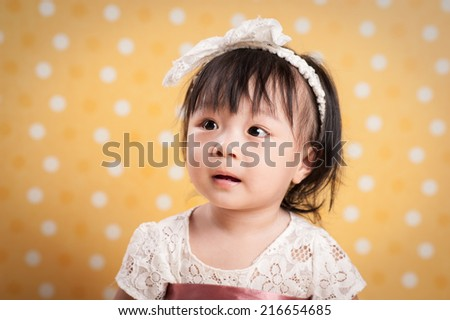 Looking up with surprised expression. - stock photo