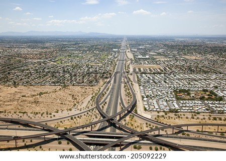 Looking West from the Loop 202 Red Mountain and U.S. 60 Superstition freeway interchange in Mesa towards Tempe and Phoenix, Arizona - stock photo