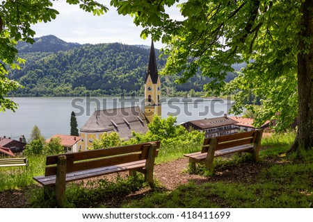 lookout point above schliersee village with wooden benches, upper bavaria - stock photo