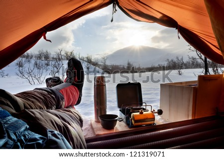Lookout the Tent on a expedition at Sunrise - stock photo