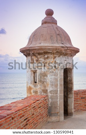 Lookout tower at El Morro Castle fort in old San Juan, Puerto Rico at sunset.