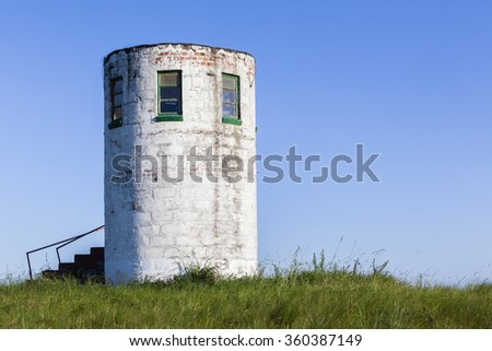 Lookout Tower Hillside Lookout tower hillside structure hilltop rural countryside landscape. - stock photo