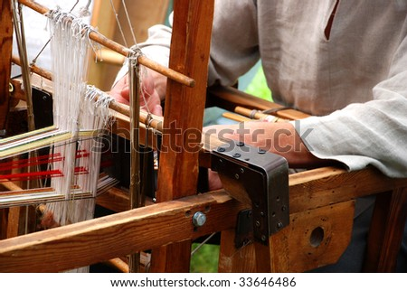Loom and hands - stock photo