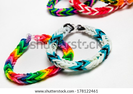Loom bracelets on a white background - stock photo