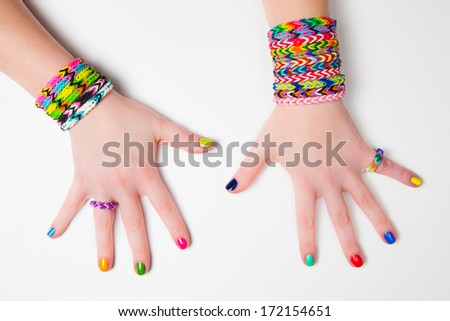 Loom bracelets on a young girl's hand. Close up. Young fashion concept - stock photo