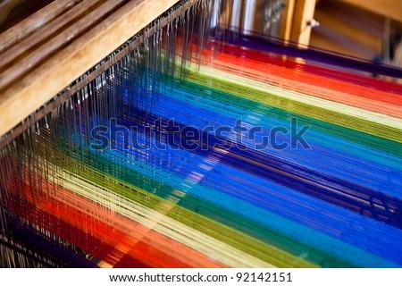 loom weaving close up shot - stock photo