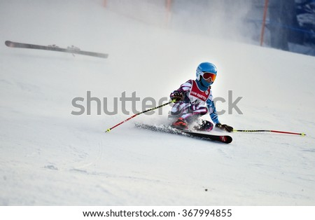 LOON MOUNTAIN USA - JANUARY 24: Tina Sutton Memorial. Unidentified participant felt down and lost one ski during junior ski race on January 24, 2016 at the Loon Mountain in NH, USA   - stock photo