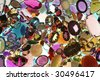 Loose assortment of colored gem stones - stock photo