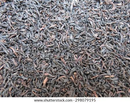 Loose black green tea leaves  background - stock photo