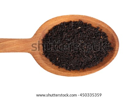 Loose dried black tea leaves on wooden spoon. Isolated on white background. Directly Above.