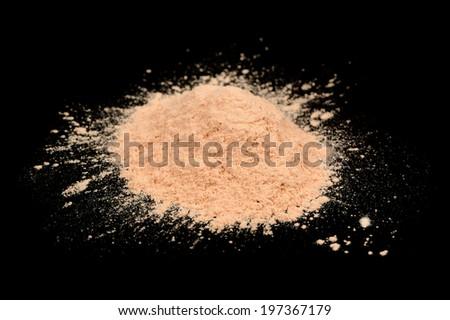Loose Face Powder on Black Background - stock photo