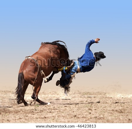 Loose Girth Causing a Cowboy to Fall isolated with clipping path - stock photo