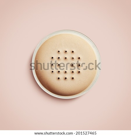 loose powder from above on a pink background - stock photo