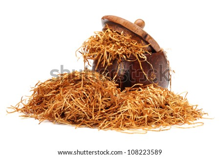 Loose shredded tobacco on white background