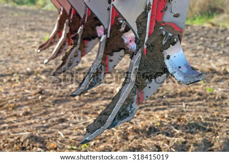 Loosening carried out in the fields of machinery - stock photo