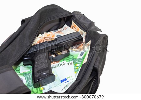 Loot from bank robbery - Sports bag full of money with gun-cutout - stock photo