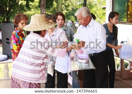 LOP BURI ,THAILAND - OCT 22 : Incorporation and volunteers collected relief supplies for sufferers about flood crisis in Thailand on October 22, 2011 in Lop Buri, Thailand.   - stock photo