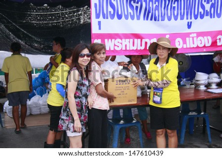 LOP BURI ,THAILAND - OCT 24 : Incorporation and volunteers collected relief supplies for sufferers about flood crisis in Thailand on October 24, 2011 in Lop Buri, Thailand.  - stock photo
