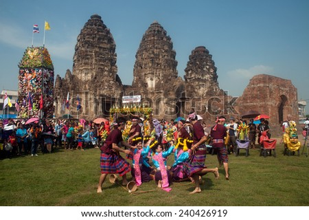 LOPBURI,THAILAND-NOV 30 : Unidentified students which is the art of traditional dance. show tourists, visitors in Thailand Monkey Party on November 30,2014,Phra Phrang Sam Yod temple,Lopburi,Thailand. - stock photo