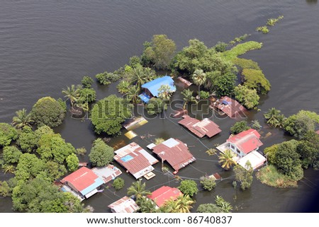 LOPBURI, THAILAND - OCTOBER 13: View from the top of Heavy flooding in Tawung, Lopburii province, Thailand on October 13, 2011 in Lopburi, Thailand. - stock photo