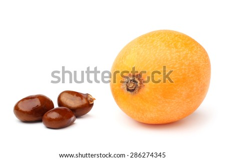 Loquat medlar and seed on white background - stock photo