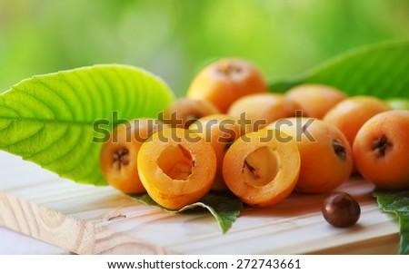 Loquat medlar on on table - stock photo
