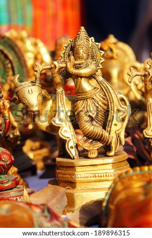 lord krishna with cow in dilli haat shop - stock photo
