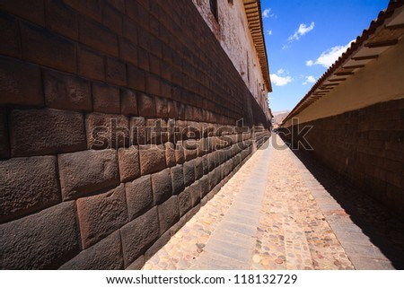 Loreto street, perspective of a Inca foundations in Cuzco, Peru. - stock photo