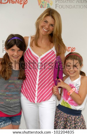 Lori Loughlin and daughters at the 2010 A Time For Heroes Celebrity Picnic, Wadsworth Theater, Los Angeles, CA. 06-13-10