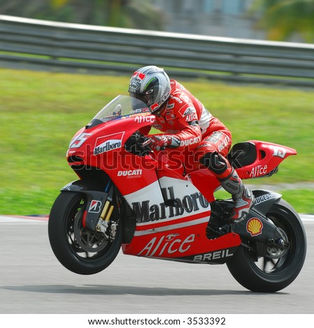Loris Capirossi exiting a corner in a wheely - stock photo