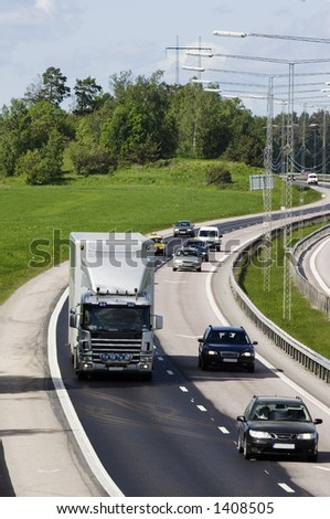 lorry and traffic on highway - stock photo