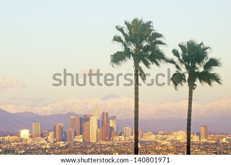 Los Angeles and snowy Mount Baldy as seen from the Baldwin Hills, Los Angeles, California - stock photo