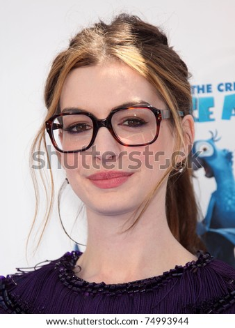LOS ANGELES - APR 10:  Anne Hathaway arrives to the 'RIO' Los Angeles Premiere  on April 10, 2011 in Hollywood, CA - stock photo