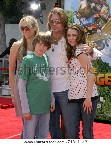 "LOS ANGELES - APR 30:  Billy Ray Cyrus & daughter Miley Cyrus arrive at the ""Over the Hedge"" LA Premiere at Mann's Village Theater on April 30, 2006 in Westwood, CA - stock photo"