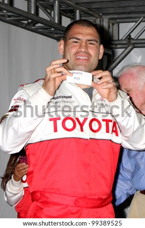 LOS ANGELES - APR 3:  Cain Velasquez at the 2012 Toyota Pro/Celeb Race Press Day at Toyota Long Beach Grand Prix Track on April 3, 2012 in Long Beach, CA