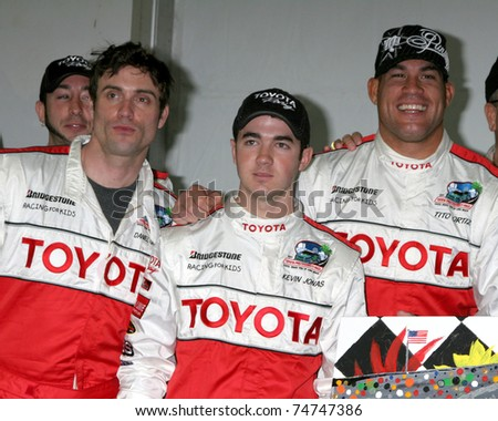 LOS ANGELES - APR 5:  Daniel Goddard, Kevin Jonas, Tito Ortiz at the Toyota Pro/Celeb Race Press Day 2011 at Long Beach Grand Prix Toyota Compound on April 5, 2011 in Long Beach, CA
