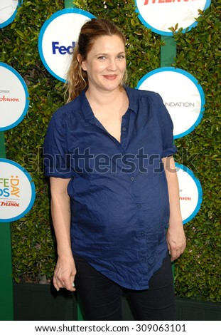 LOS ANGELES - APR 5:  Drew Barrymore  arrives at the SAFE KIDS EVENT  on April 5, 2014 in West Hollywood, CA                 - stock photo
