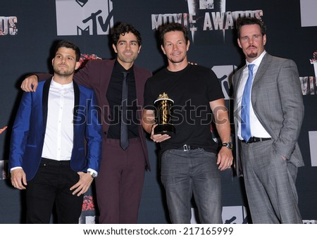 LOS ANGELES - APR 13:  Jerry Ferrera, Adrian Grenier, Mark Wahlberg & Kevin Dillion in the 2014 MTV Movie Awards - Press Room  on April 13, 2014 in Los Angeles, CA.                 - stock photo