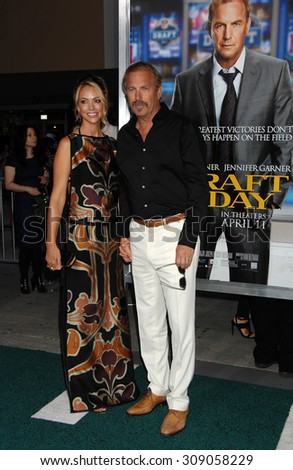 LOS ANGELES - APR 7:  Kevin Costner and wife Christine Baumgartner arrives at the DRAFT DAY LOS ANGELES PREMIERE   on April 7, 2014 in Westwood, CA                 - stock photo