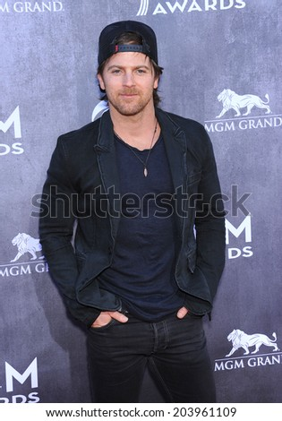 LOS ANGELES - APR 06:  Kip Moore arrives to the 49th Annual Academy of Country Music Awards   on April 06, 2014 in Las Vegas, NV.                 - stock photo
