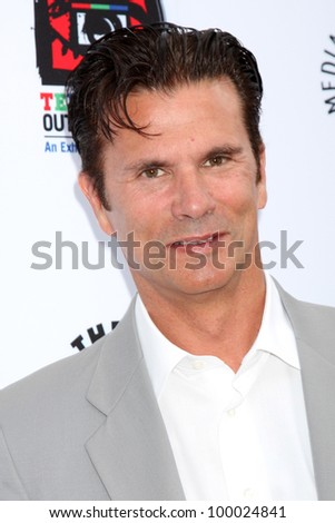 "LOS ANGELES - APR 12:  Lorenzo Lamas arrives at Warner Brothers ""Television: Out of the Box"" Exhibit Launch at Paley Center for Media on April 12, 2012 in Beverly Hills, CA - stock photo"