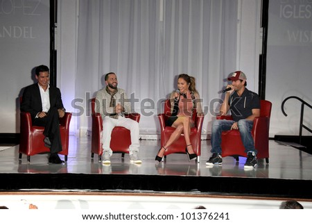 LOS ANGELES - APR 30:  Mario Lopez, Yandel, Jennifer Lopez, Enrique Iglesias at a press conference to announce a Summer Tour at Boulevard3 on April 30, 2012 in Los Angeles, CA - stock photo
