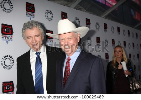 "LOS ANGELES - APR 12:  Patrick Duffy, Larry Hagman arrives at Warner Brothers ""Television: Out of the Box"" Exhibit Launch at Paley Center for Media on April 12, 2012 in Beverly Hills, CA - stock photo"