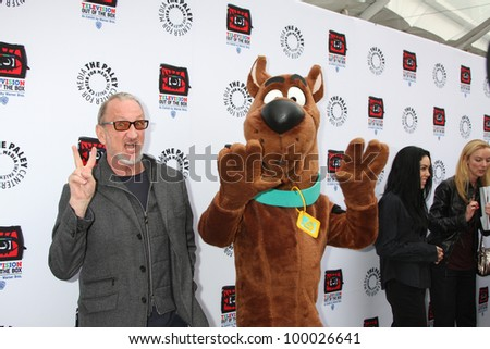 "LOS ANGELES - APR 12:  Robert Englund, Scooby-Doo arrives at Warner Brothers ""Television: Out of the Box"" Exhibit Launch at Paley Center for Media on April 12, 2012 in Beverly Hills, CA - stock photo"