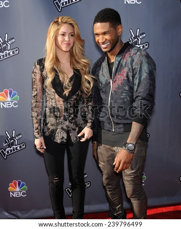 LOS ANGELES - APR 03:  Shakira & Usher arrives to the 'The Voice Celebrtaes Season 5  on April 03, 2014 in Hollywood, CA                 - stock photo