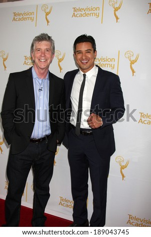"LOS ANGELES - APR 9:  Tom Bergeron, Mario Lopez at the An Evening with ""America's Funniest Home Videos"" at Academy of Television Arts and Sciences on April 9, 2014 in North Hollywood, CA - stock photo"