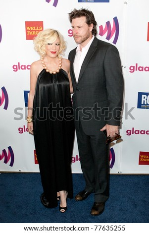 LOS ANGELES - APR 10: Tori Spelling (L) and Dean McDermott (R) arrive at the 22nd annual GLAAD Media Awards at Westin Bonaventure Hotel on April 10, 2011 in Los Angeles, CA. - stock photo