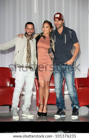 LOS ANGELES - APR 30:  Yandel, Jennifer Lopez, Enrique Iglesias at a press conference  to announce their Summer Tour at Boulevard3 on April 30, 2012 in Los Angeles, CA - stock photo