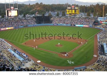 LOS ANGELES - APRIL 25: A baseball game at Dodger Stadium on April 25, 2007 in Los Angeles, California. Opened in 1962 at a cost of $23 million, the famous ballpark seats 56,000 fans. - stock photo