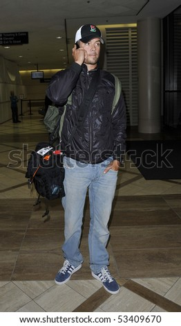 LOS ANGELES - APRIL 24: Actor Josh Duhamel husband to rocker Fergie from the Black Eyed Peas is seen on the telephone at LAX. April 24, 2010 in Los Angeles, California